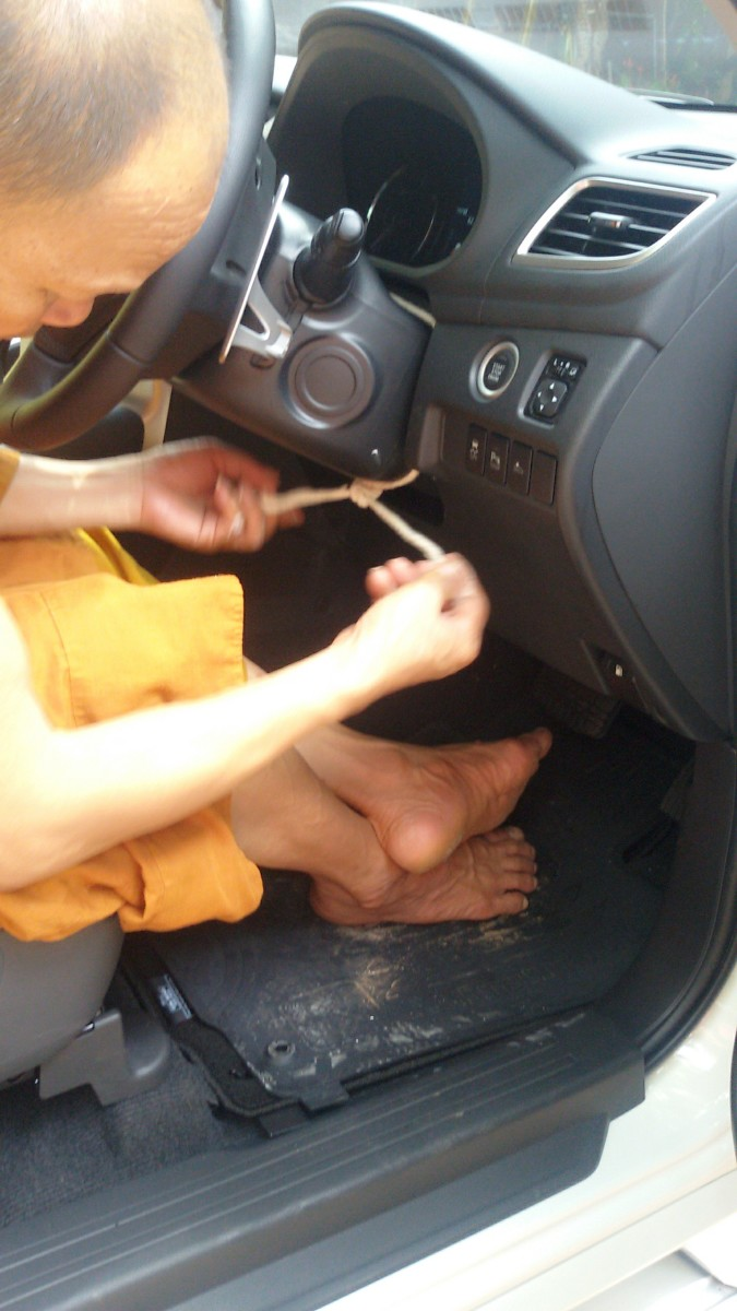 Attaching a sacred white cord around the steering column