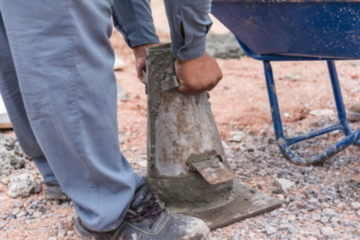 Only take your feet off when you are ready to lift the slump cone and measure the slump.