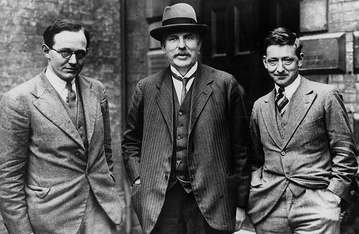(from left to right) Ernest Walton, Ernest Rutherford, and John Cockroft .