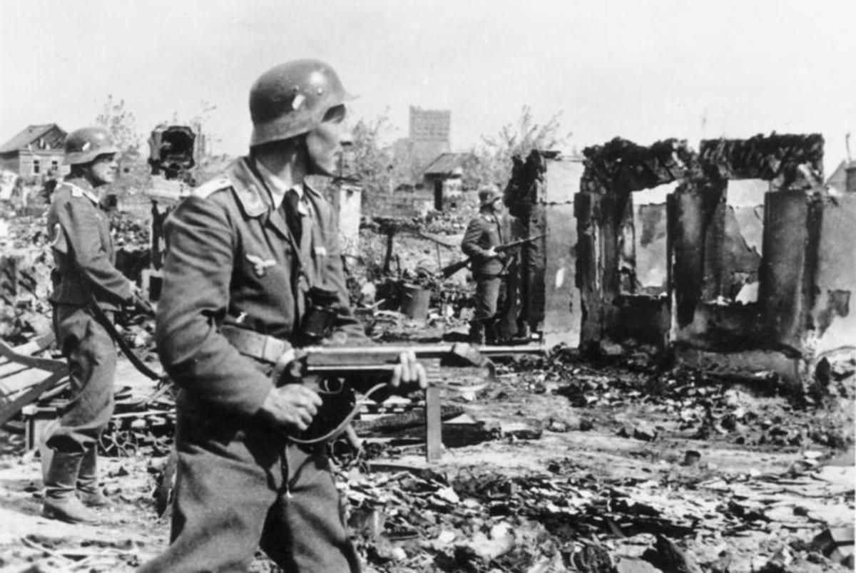 German soldiers advancing into Stalingrad's bombed out remains.