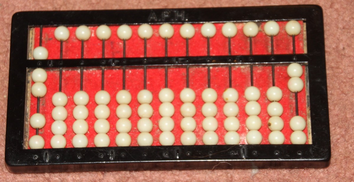 This abacus shows the improper fraction: 7/2.