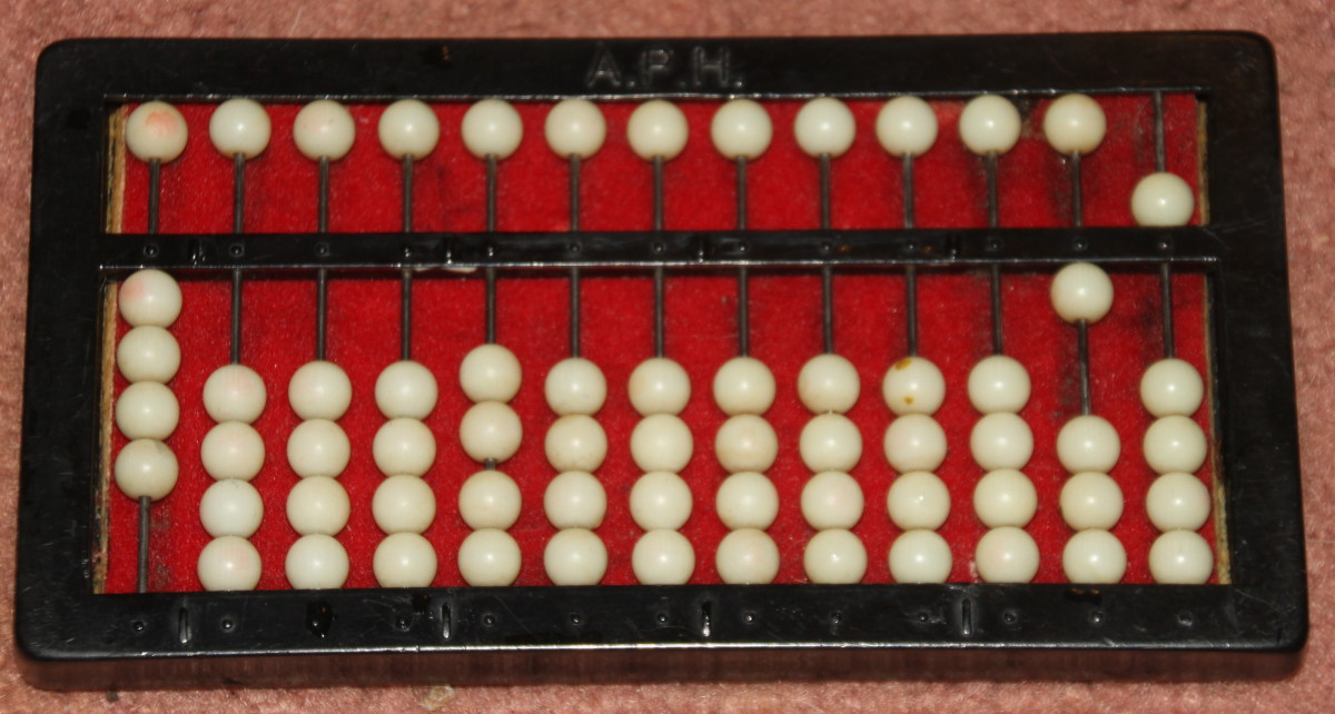 The abacus shows the result of 2/3 – 2/5. The answer is 4/15.