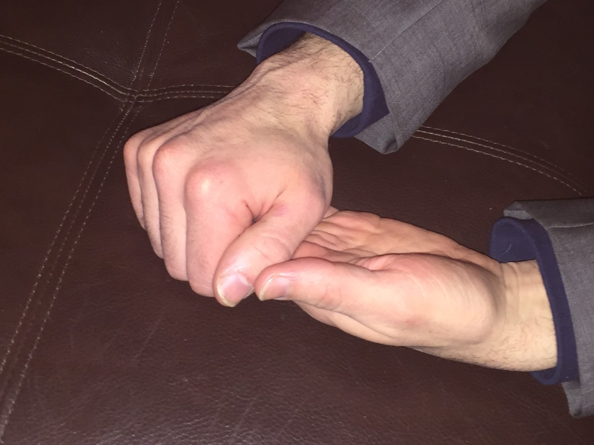 Holding the fingers hand clasp.