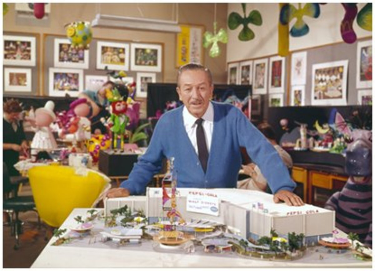 "Walt Disney with a model of the ""It's A Small World"" ride.  His company would design three other attractions at the fair, and inspire other pavilions to include Disneyesque attractions."