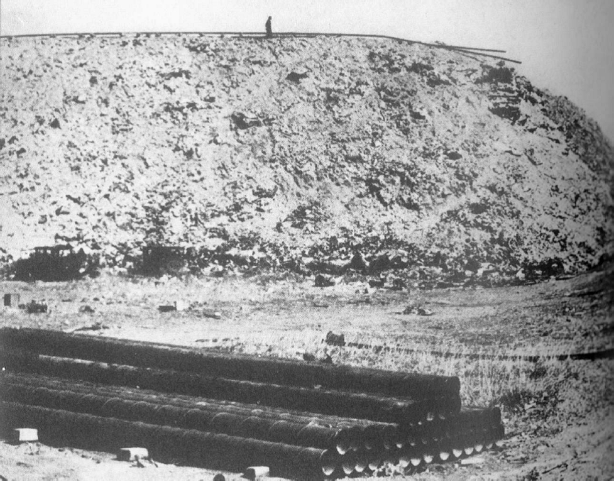 A ground view of the Corona Ash Dumps. That black spot on the top of the mound is a human, giving you an idea of how tall these mounds grew to. And by this time the entire dump was filled with these giant mounds.