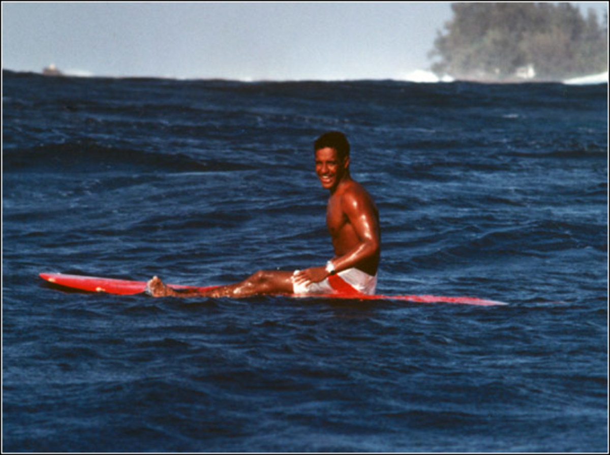 Eddie Aikau, 1967, on his ever-present surfboard.