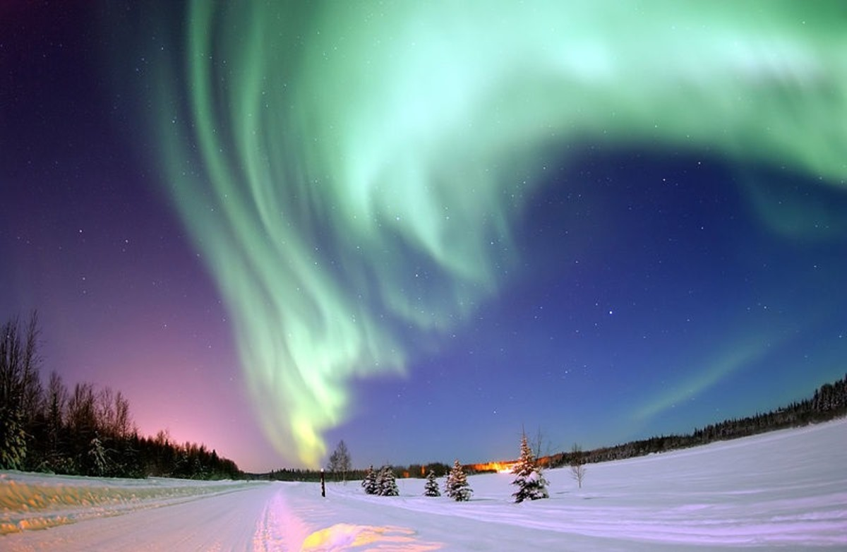 The Aurora Borealis is caused when plasma ejected from the surface of the Sun interacts with the Earth's atmosphere.