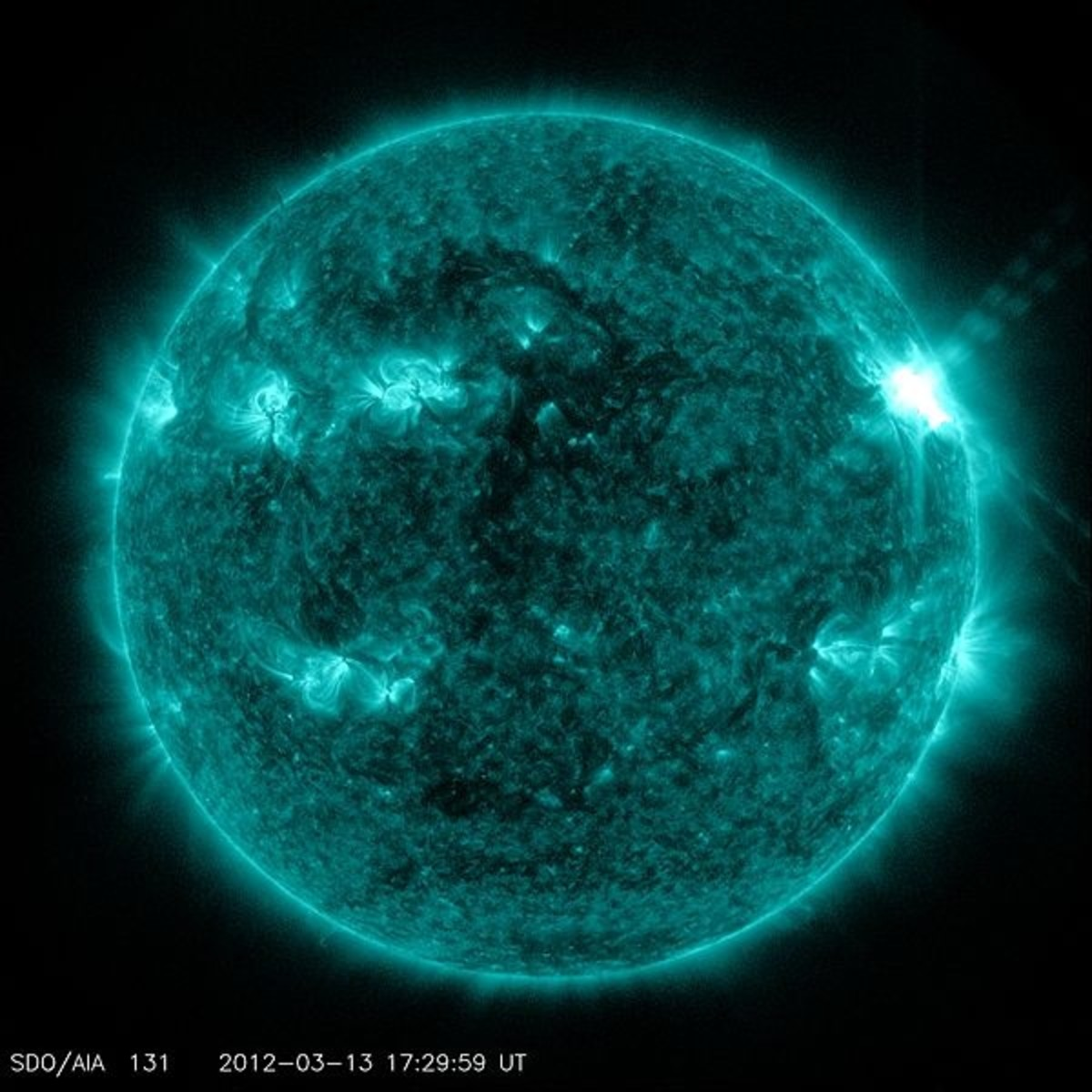 Seen through special filters, solar flares are intense bursts of radioactivity closely associated with sunspots. Sunspots are caused by variations in the magnetic field.