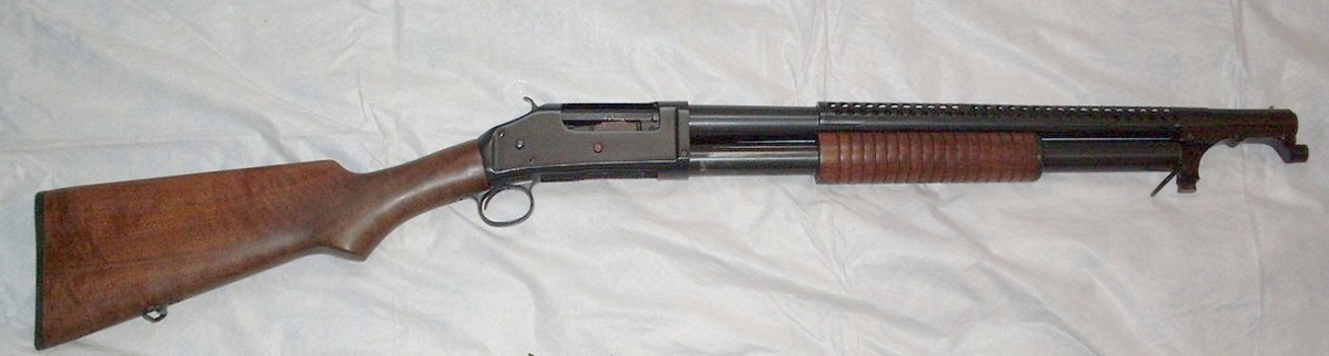 WWI: Model 97 Trench Gun. Note the barrel's heat shield and bayonet adapter at the front of the barrel.