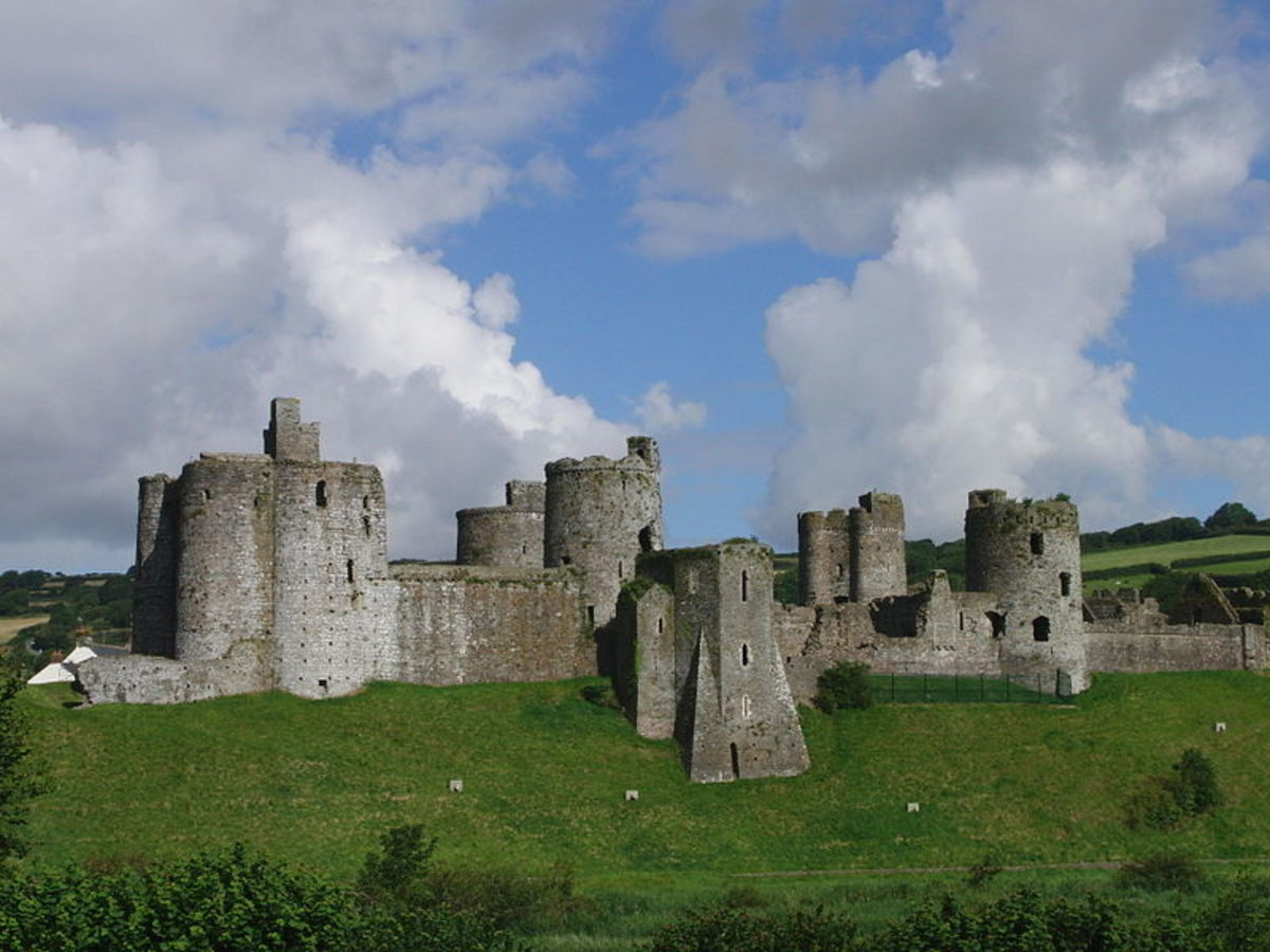 The east side of Kidwelly Castle, Wales, UK seen from a nearby hill.