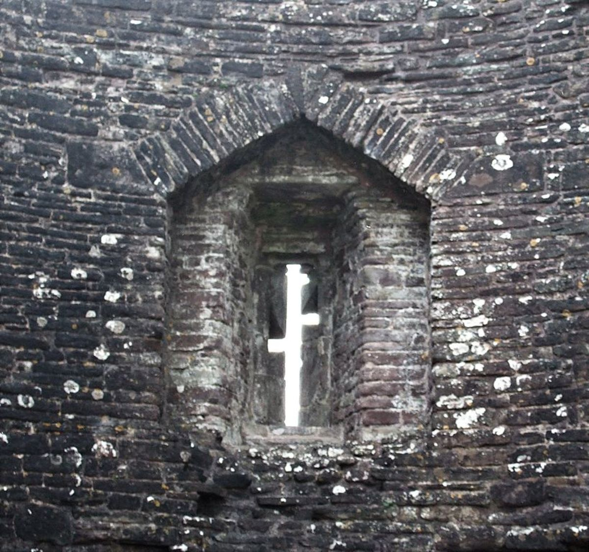 Narrow arrow slit window at White Castle, Wales.