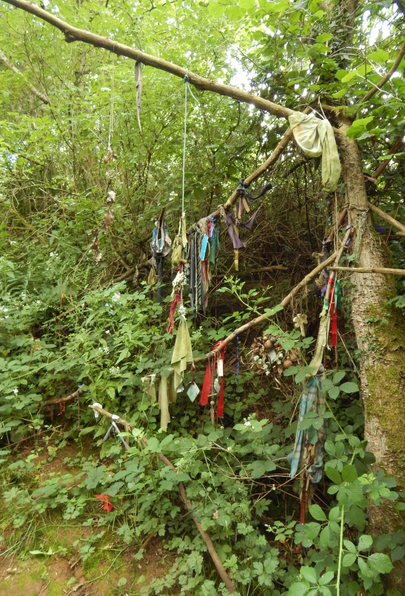The rough remains of an earlier well can be found at the bottom of this wishing tree.