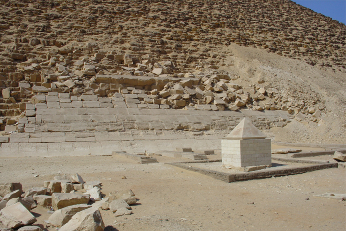 "The capstones (tips) of pyramids and obelisks were referred to as ""benbenet"" by the Egyptians, indicating a connection with the Benben stone. This particular capstone once topped the Red Pyramid at Dahshur, beside which it now stands on display."