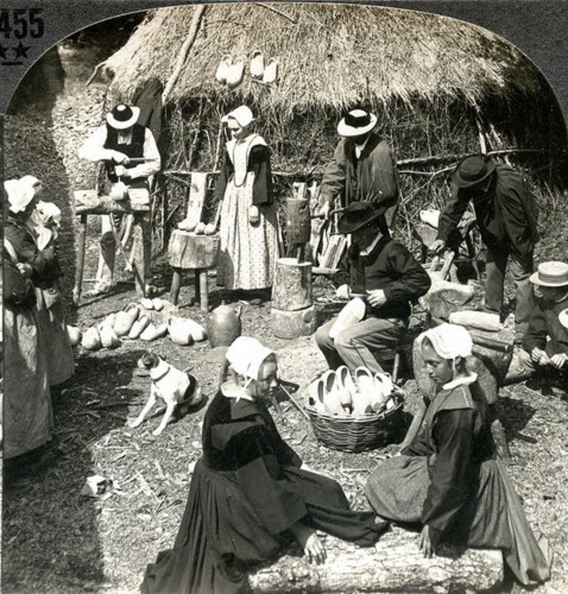 Breton peasants making sabots or wooden shoes.