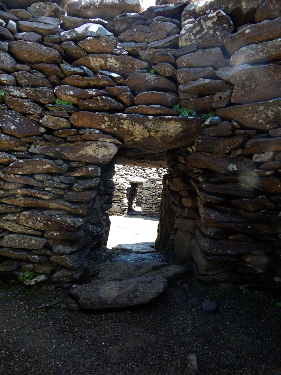 Inside one of the larger Fahan structures. This Clochán is made of three interconnected huts and contains a fire pit.