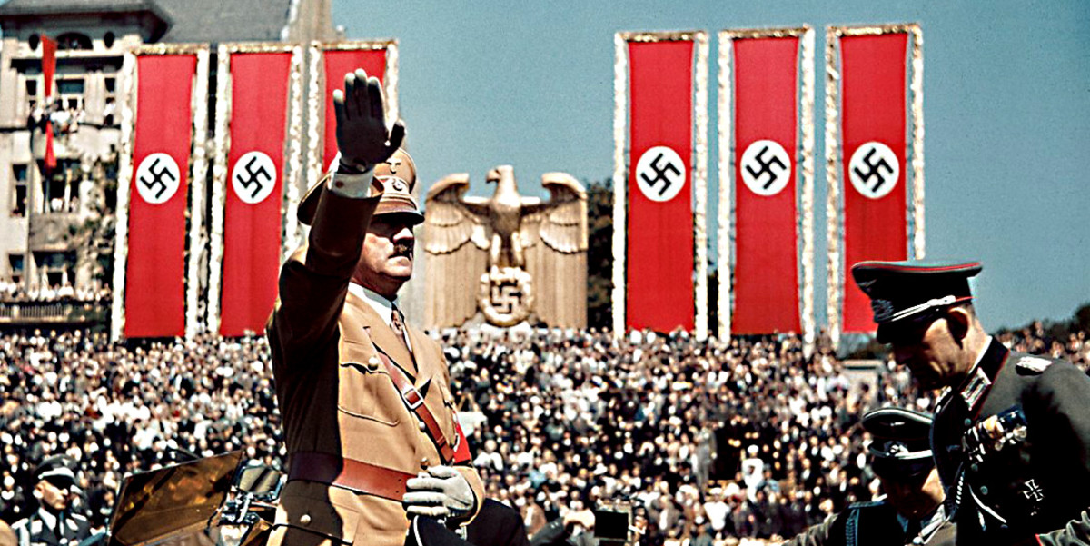 Nazi swastika banners in the backgraound add to the Hitler propaganda image