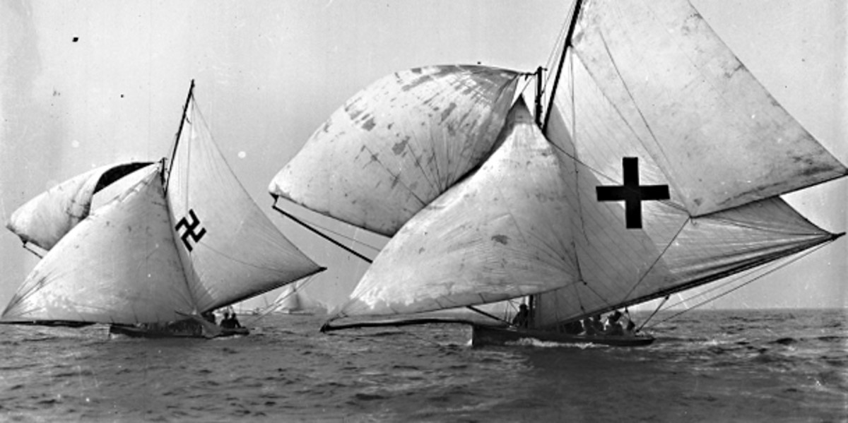 Two yachts sailing in Sydney Harbour Australia, c1926. One carries a conventional cross as a decorative motif, but look at the one on the left