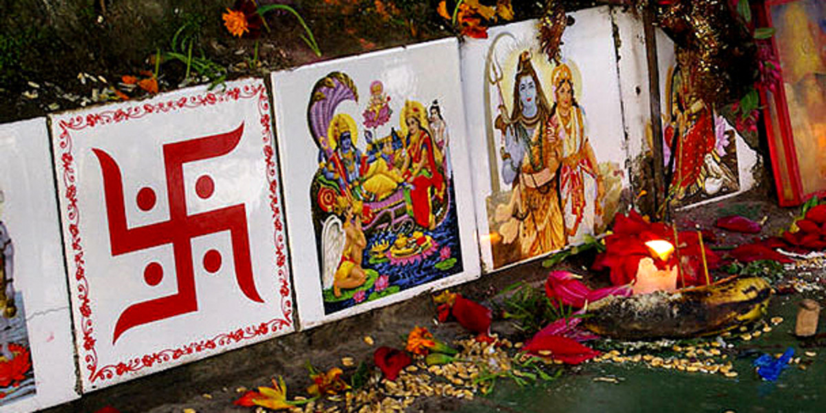A right pointing swastika seen here with other decorative religious imagery - this swastika symbol is revered by hundreds of millions of Hindus throughout the world
