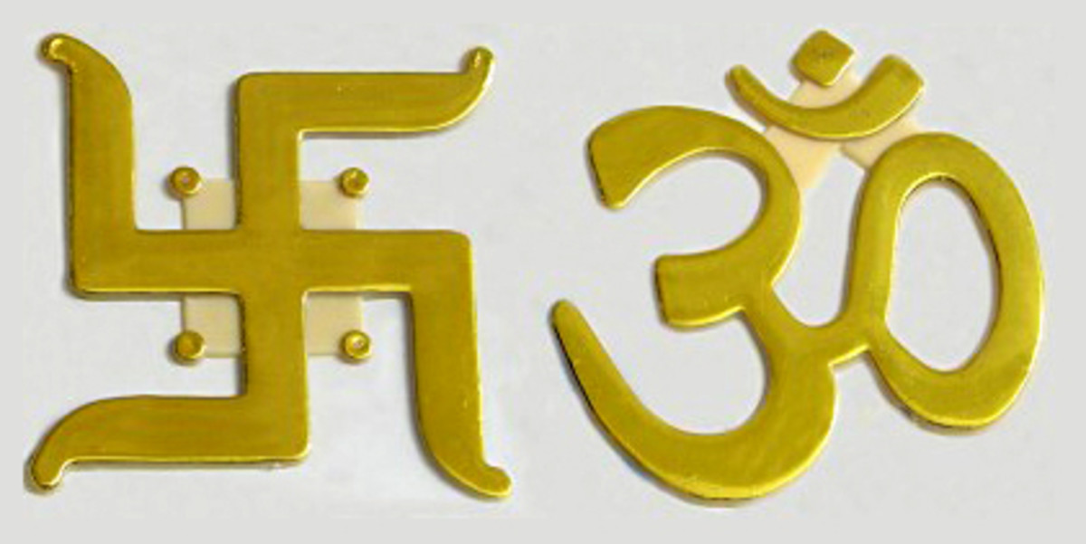 The swastika and the aum (om). The aum, which looks like the number 30, is the most sacred symbol in Hinduism. But the second most revered symbol is the swastika