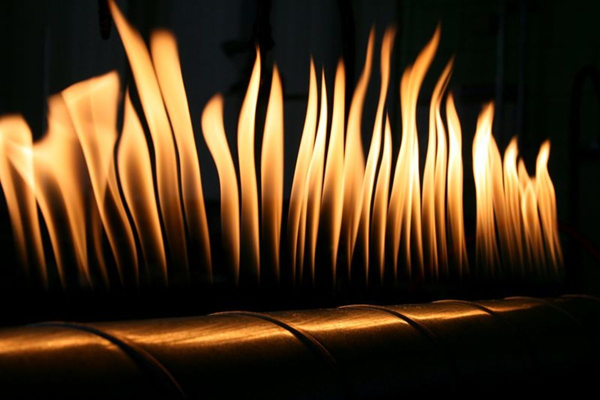 This metallic tube named after Heinrich Rubens has a long line of small holes in which propane is sparked up to get a long row of uniform flames. When a speaker is placed at one end, the compression and rarefaction create pressure difference.