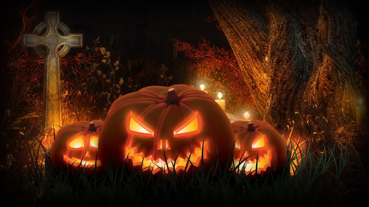 Jack O'Lanterns with a Celtic Cross in the background