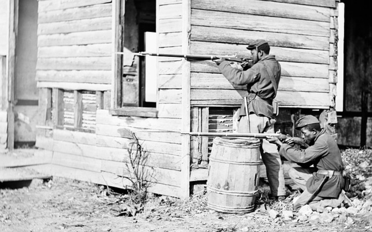 African American soldiers fighting in the American Civil War.  The American Civil War saw the first signs of mechanized warfare, which would become more apparent with the onset of World War I later in Europe.