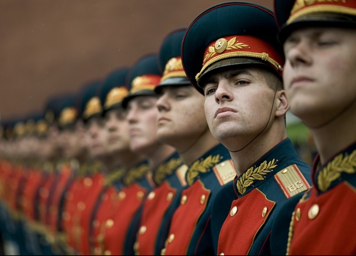 Russian soldiers in ceremonial uniforms.  Most military groups have traditions, customs, special dress and awards that provide soldiers with recognition within a wider cultural framework.
