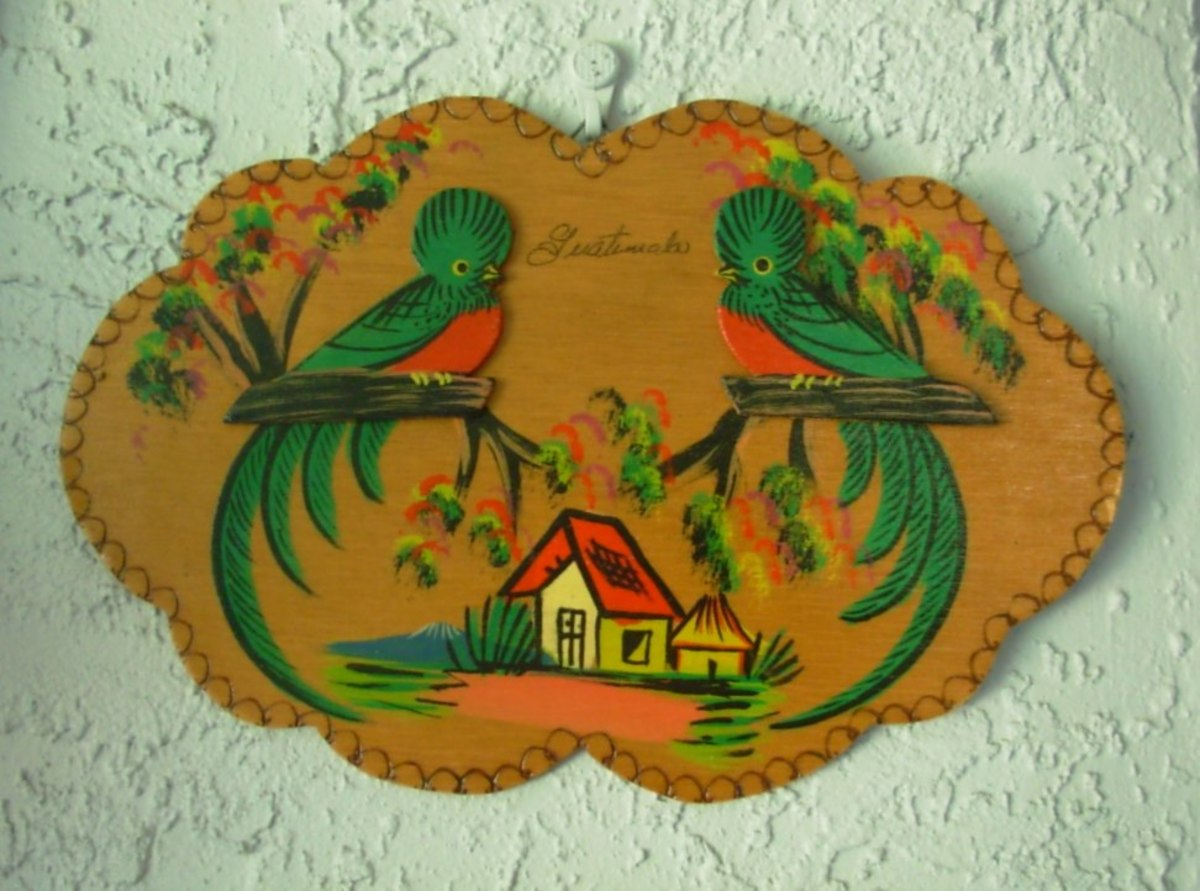 A souvenir plaque purchased in Guatemala showing two quetzals.