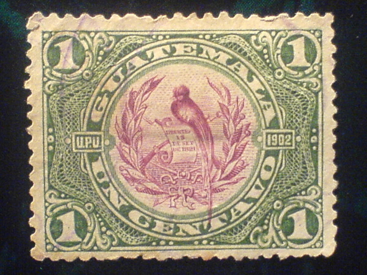 A postage stamp from Guatemala features a quetzal.