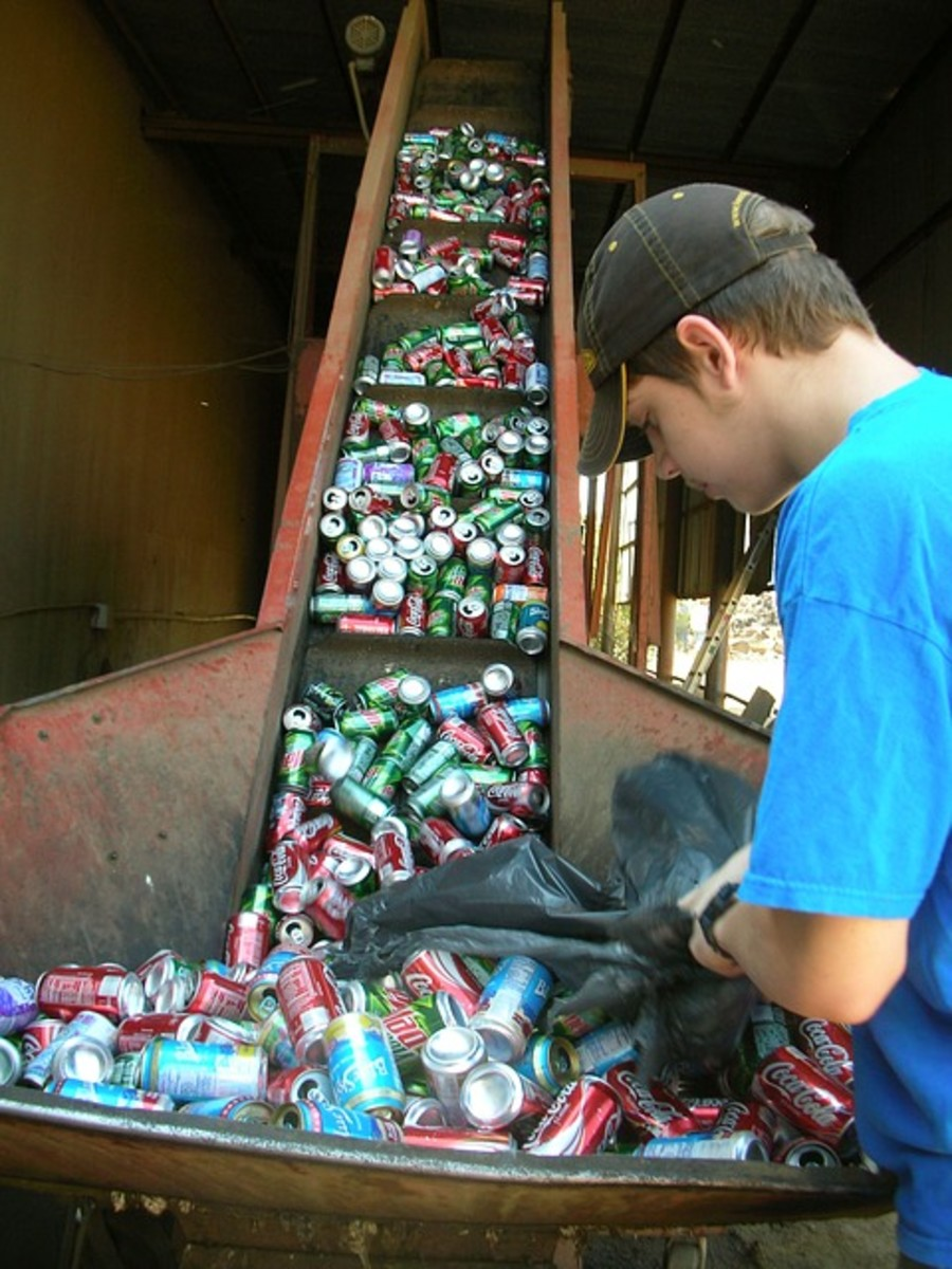 Organizing cans at a waste management center.  Pretty much all metal can be melted down and re-used.  Some types of metal have a scrap value too, and can actually make you some money.