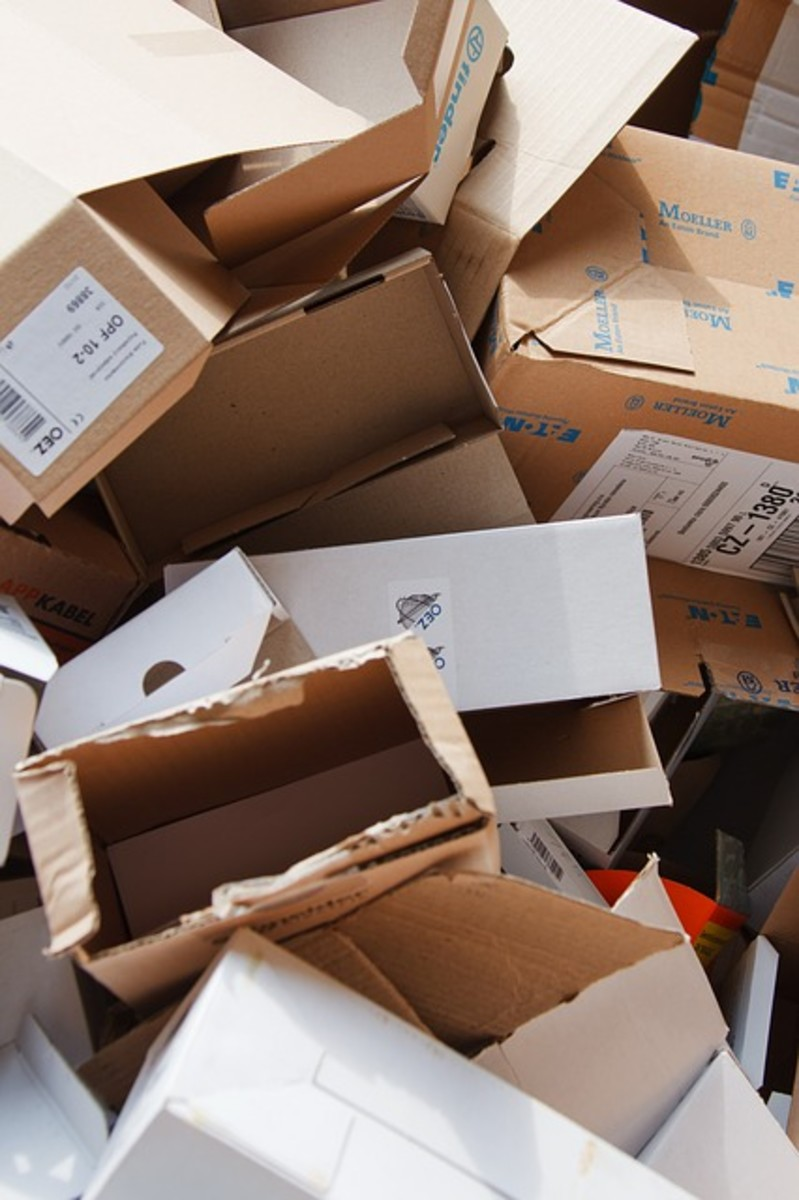 Pile of used and empty cardboard boxes.  Paper and cardboard can be collected and recycled.  Boxes should be flattened so that they take up less space.