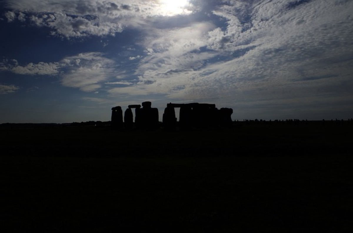 Stonehenge at night.  Even the silhouette of the stone circle is iconic and instantly recognizable to many people.  The monument is managed by English Heritage and a  UNESCO World Heritage Site.