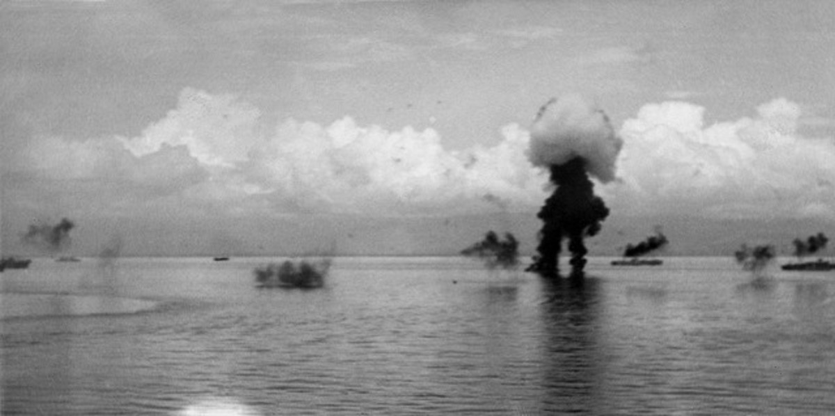 Allied warships sinking off the beaches of Guadalcanal