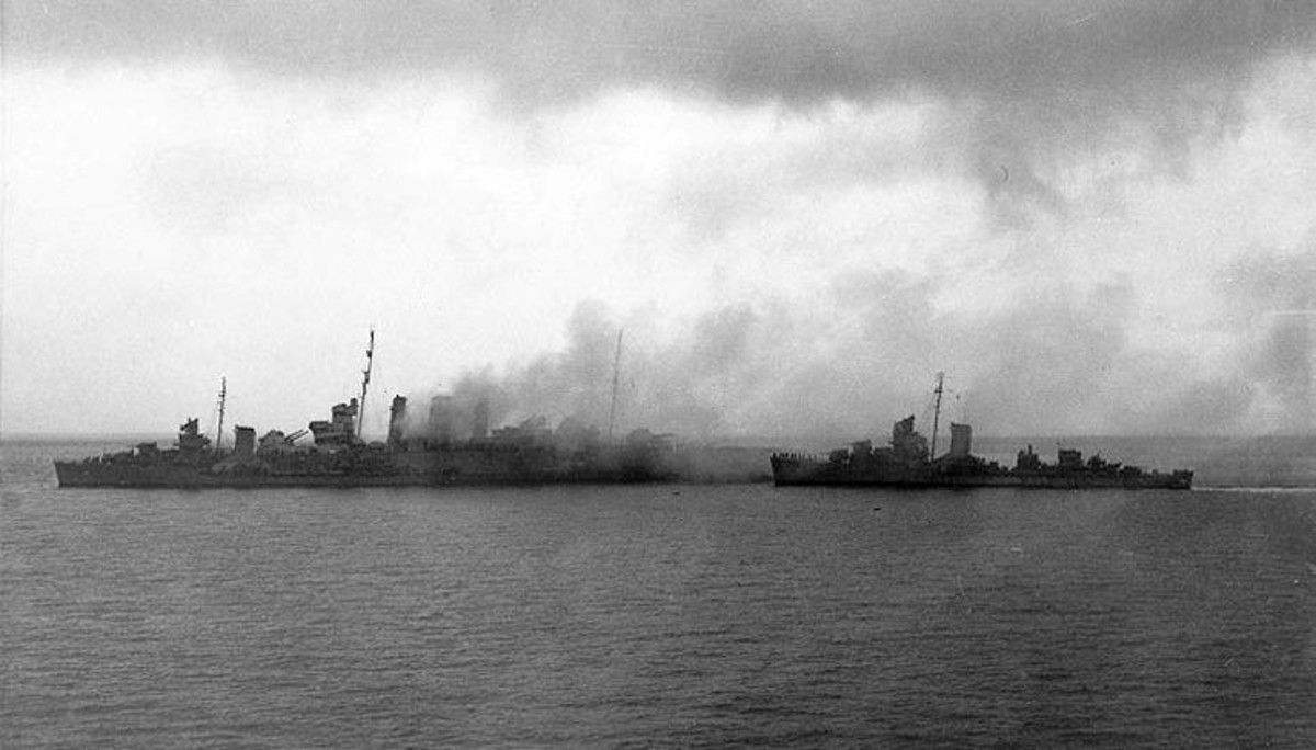 American destroyers rescuing the surviving crew from the Australian flagship Canberra after the Battle of Savo Island. The Canberra suffered 24 hits from Japanese warships it would sink soon after this picture was taken.