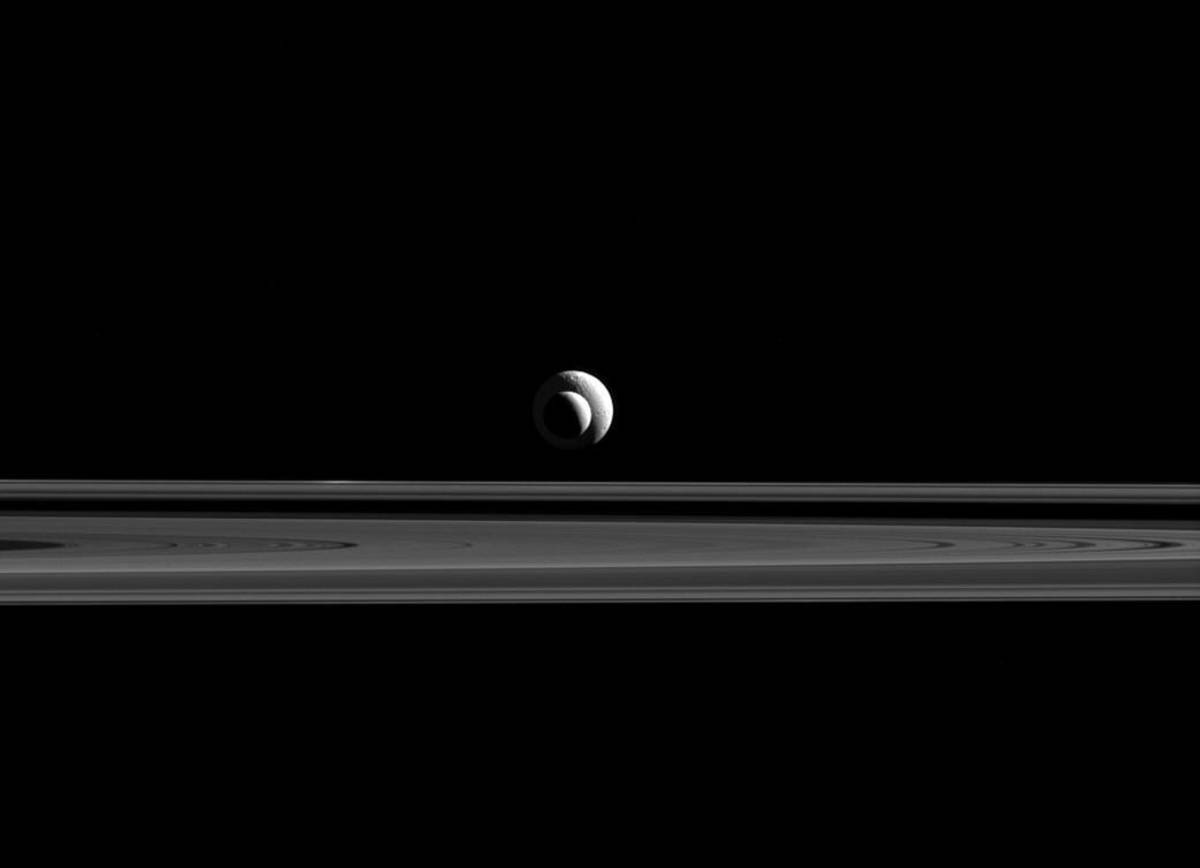 Enceladus at 1.3 million miles way and Tethys at 1.6 million miles away, taken on Sept. 24, 2015.