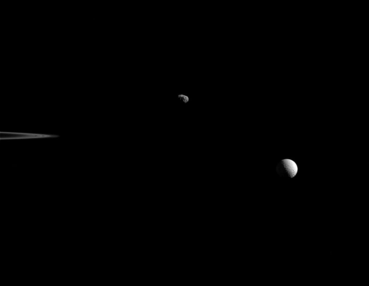 Janus (left) at 598,000 miles away and Mimas (right) at 680,000 miles away, taken on Oct. 27, 2015.