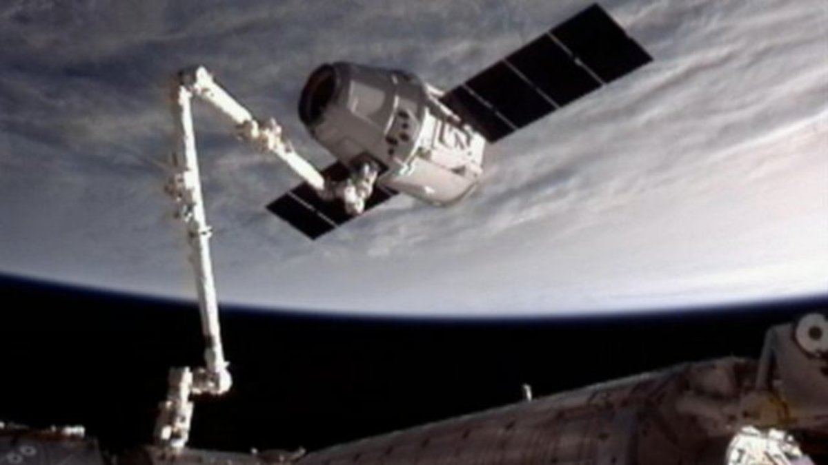 Dragon docking with the ISS.