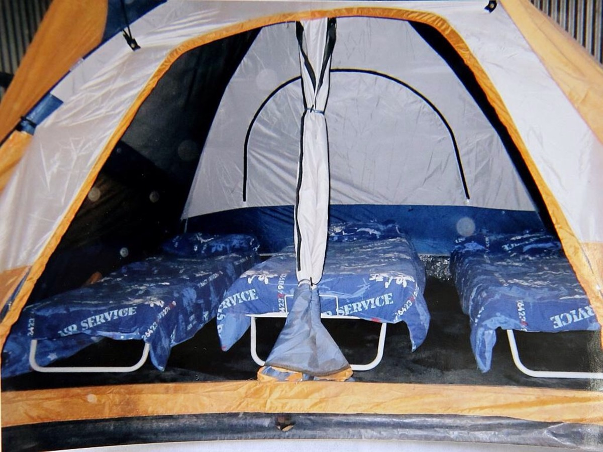 The children slept in tents inside a shed.