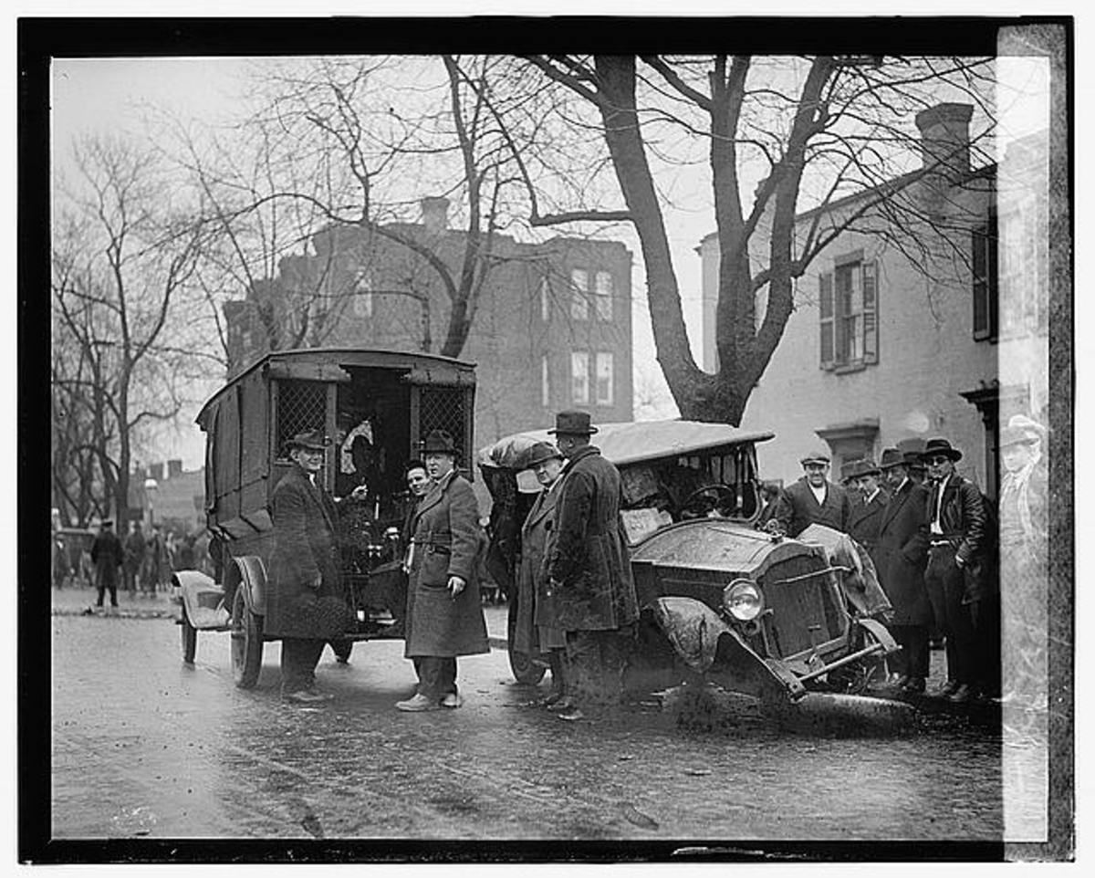 A bootlegger's wrecked car after a high speed chase with authorities. 22 January 1922