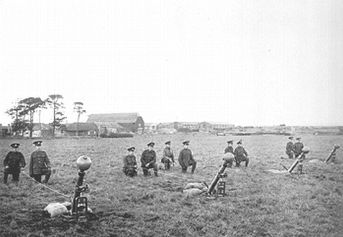 Chemical warfare experimental station at Portal Down during WW1. Image shows trials of 2-inch Toffee Apple mortar bombs (possibly for poison gas delivery?).
