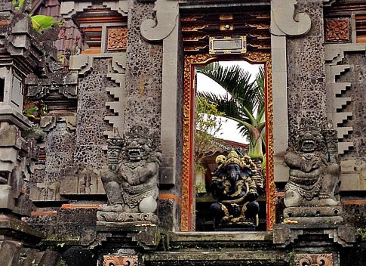 Above top: Two types of gates - paduraksa (left) and candi bentar (right).  Above bottom: Stone carvings cover the door frame of this paduraksa gate.