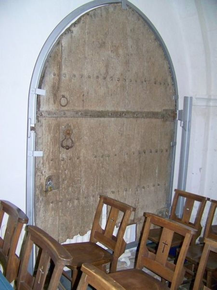 A typical oak door from the Middle Ages, reinforced with iron hinges and studs.