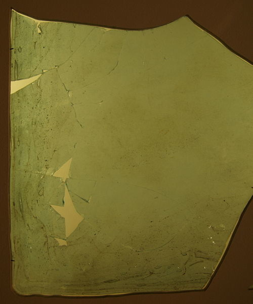 An piece of ancient Roman window glass from the 4th century and now housed in the Gäubodenmuseum in Germany.