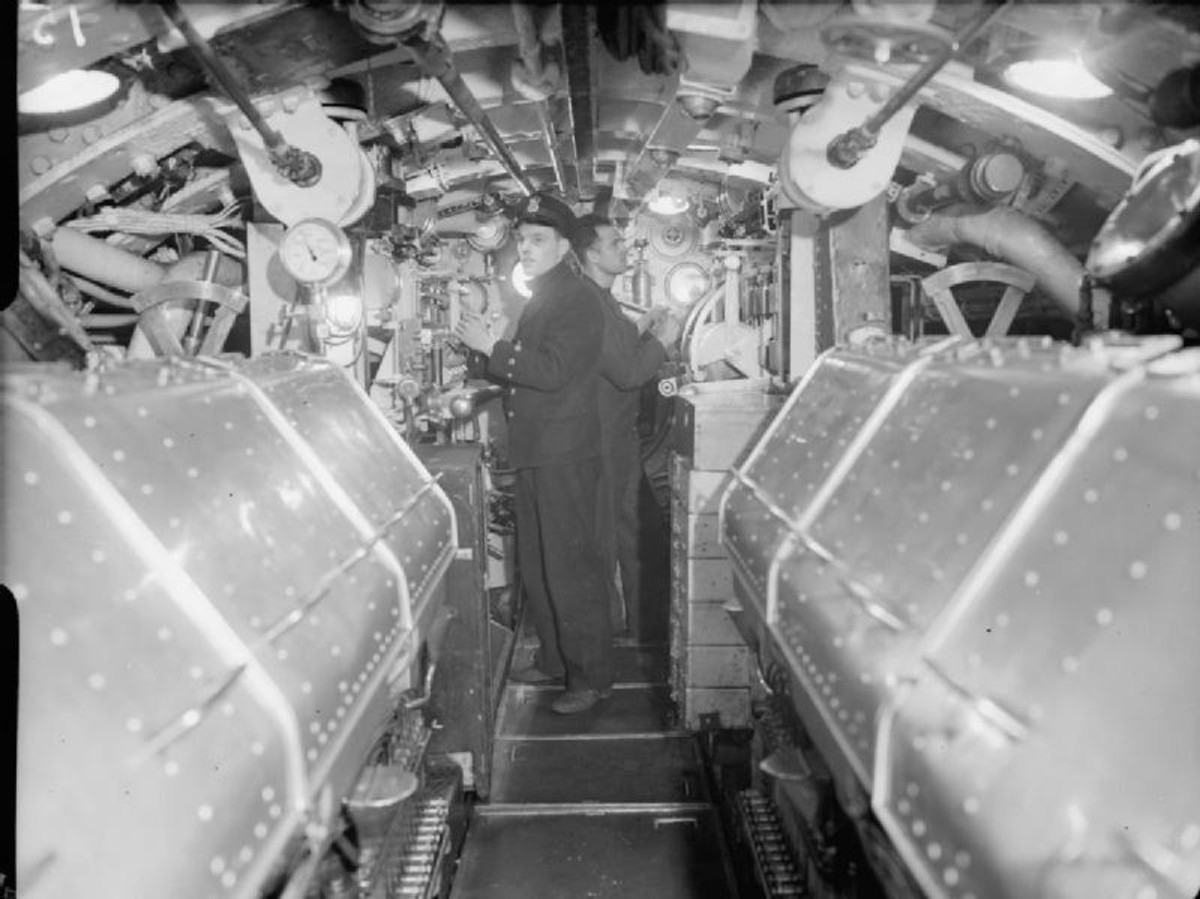 WW2: Two Royal Navy stokers in the engine room of a British submarine during World War II.