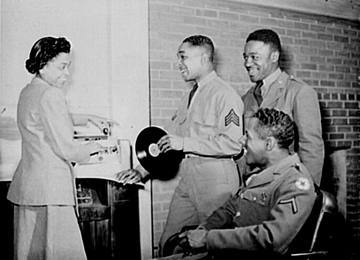 Sgt. Williams and friends with a USO hostess