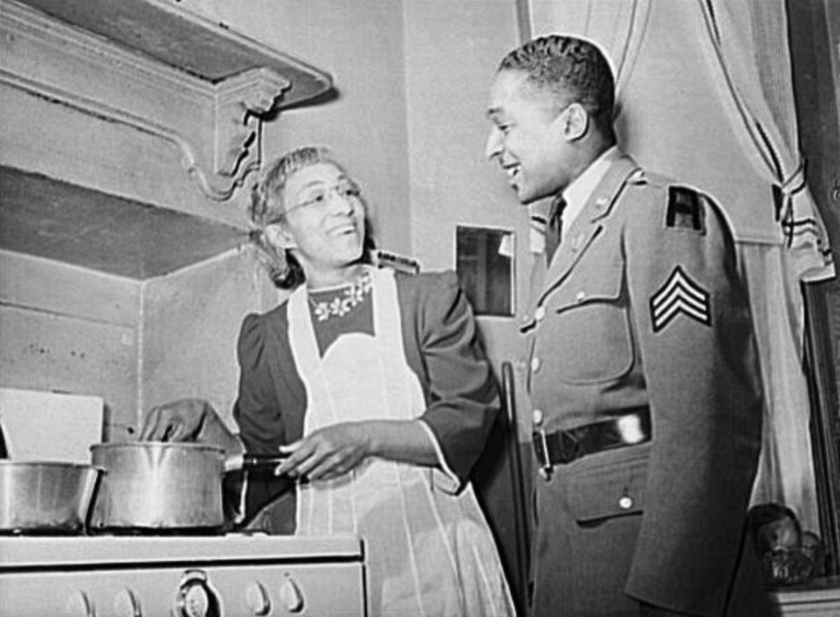 Sgt Williams watching his mother cook