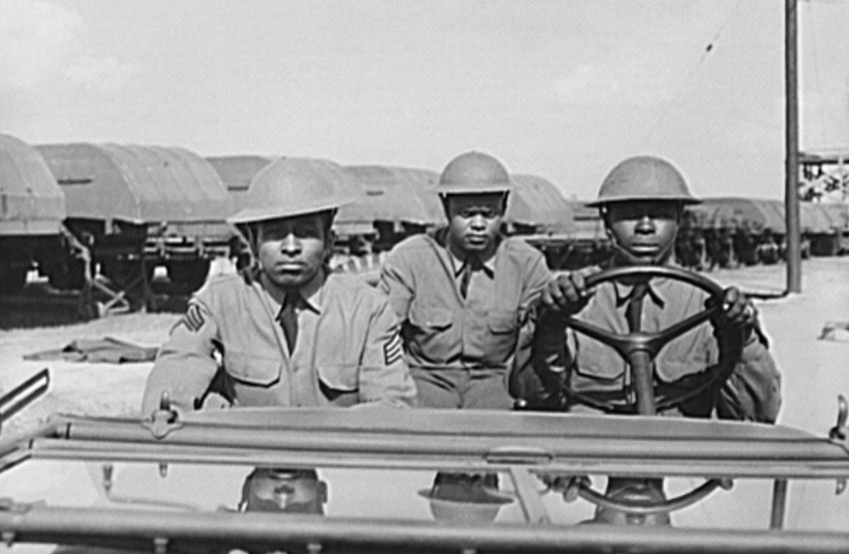 Sergeant Williams (left) in a jeep