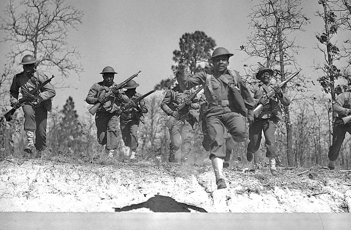 Sgt Franklin Williams leading his platoon in a charge at Fort Bragg