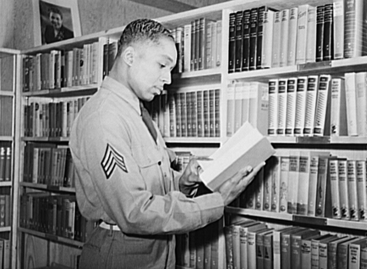 Sergeant Williams in the library of the service club at Fort Bragg, NC