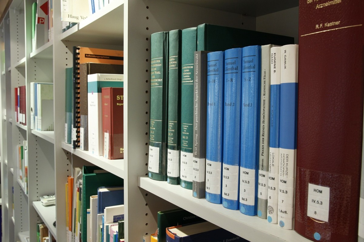 published theses on a library shelf